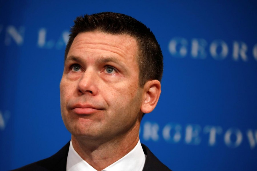 FILE PHOTO: Acting Department of Homeland Security (DHS) Secretary Kevin McAleenan reacts while protesters interrupt his remarks at the Migration Policy Institute annual Immigration Law and Policy Conference in Washington, U.S., October 7, 2019. REUTERS/Yuri Gripas