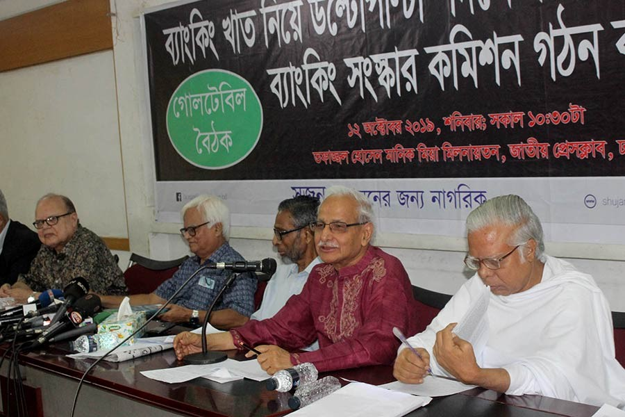 Shujan's founder secretary Dr Badiul Alam Majumder addressing a roundtable at the Jatiya Press Club on Saturday. -Focus Bangla photo