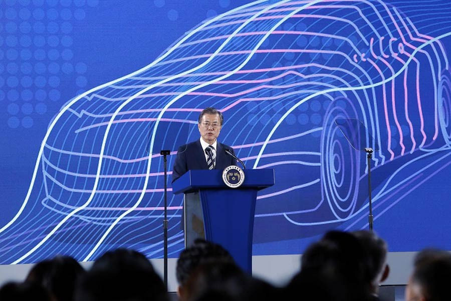 South Korean President Moon Jae-in delivering his speech during a ceremony declaring country's vision to lead future mobility tech in Hwaseong of South Korea on Tuesday. -Reuters Photo