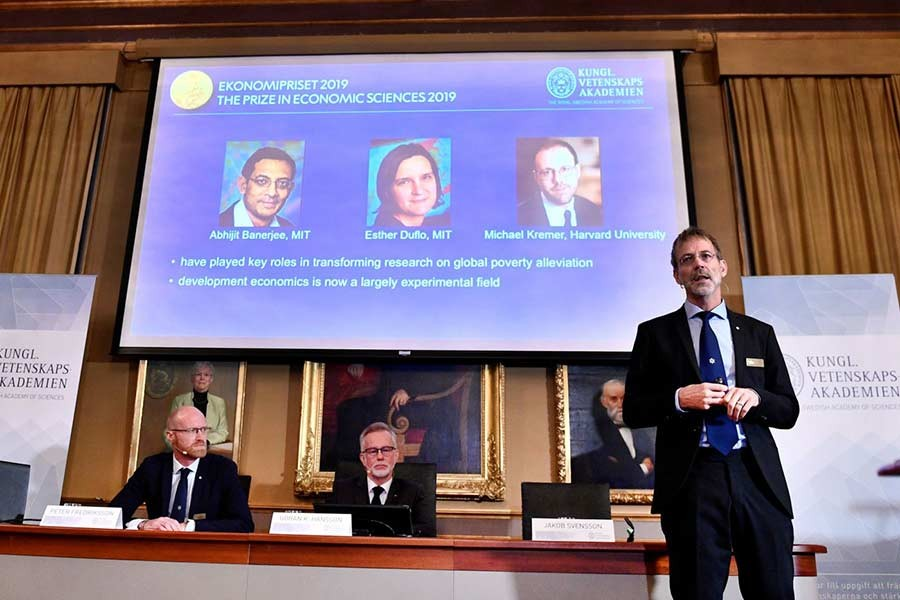 Goran K Hansson (C), Secretary General of the Royal Swedish Academy of Sciences, and academy members Peter Fredriksson (L) and Jakob Svensson, announce the winners of the 2019 Nobel Prize in Economics during a news conference at the Royal Swedish Academy of Sciences in Stockholm, Sweden, October 14, 2019. -Reuters Photo