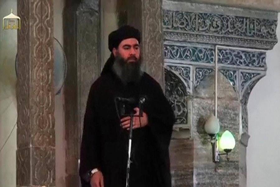 A man purported to be the reclusive leader of the militant Islamic State Abu Bakr al-Baghdadi has made what would be his first public appearance at a mosque in the centre of Iraq's second city, Mosul, according to a video recording posted on the Internet on July 5, 2014, in this still image taken from video — Social Media Website via Reuters TV/Files
