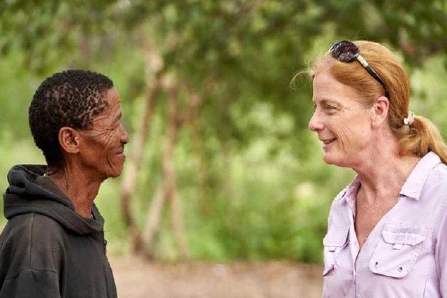 Vanessa Hayes speaks with Headman ǀkun ǀkunta, from an extended Ju/'hoansi family, who provided genome data for a study identifying the ancestral homeland in southern Africa of all living members of our species, in Namibia, Feb 6, 2019. Chris Bennett/Evolving Picture/Handout via REUTERS/File Photo
