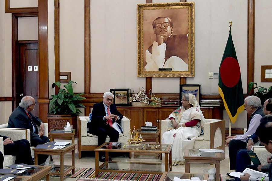 A seven-member delegation of the World Islamic Economic Forum (WIEF) and the South East Asian Cooperation (SEACO) Foundation paying a courtesy call on Prime Minister Sheikh Hasina at Ganabhaban in Dhaka on Wednesday afternoon. -PID Photo