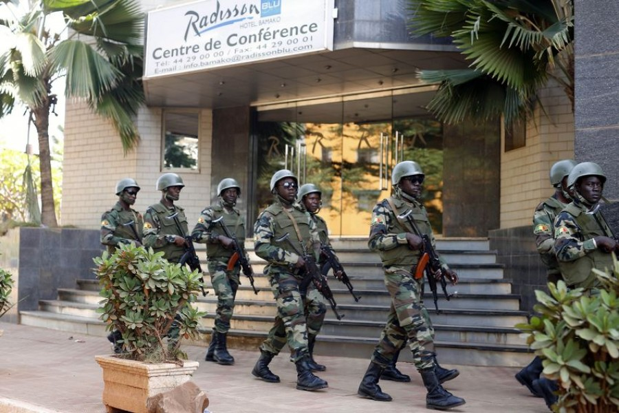 FILE- In this Saturday, Nov. 21, 2015 file photo, soldiers from the presidential guard patrol outside the Radisson Blu hotel in Bamako, Mali, after it was attacked by Islamic extremists armed with guns and grenades -  AP Photo / Jerome Delay, File