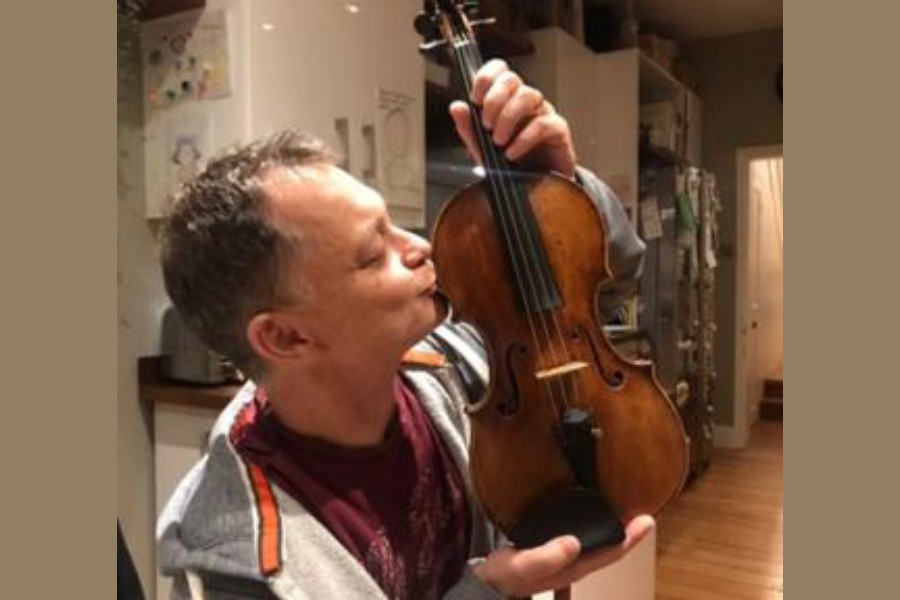 Stephen Morris was handed back his violin in a Waitrose car park - Photo courtesy: STEPHEN MORRIS