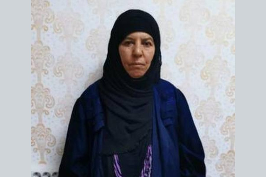 Rasmiya Awad, believed to be the sister of slain Islamic State leader Abu Bakr al-Baghdadi, who was captured on Monday in the northern Syrian town of Azaz by Turkish security officials, is seen in an unknown location in an undated picture provided by Turkish security officials.   | Photo Credit: REUTERS