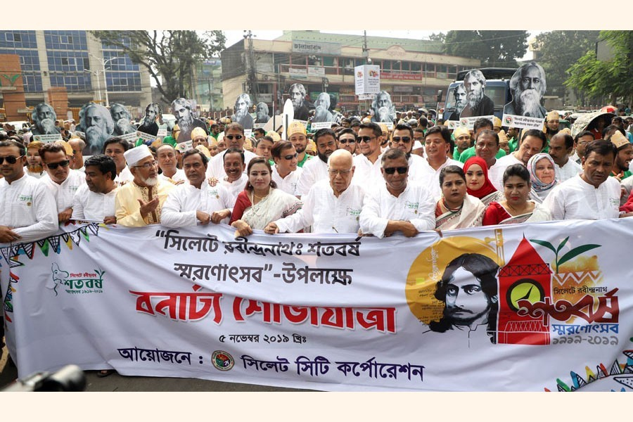 Sylhet City Corporation brought out a procession in the city on Tuesday marking 100 years of Rabindranath Tagore's Sylhet visit. Former finance minister AMA Muhith and Sylhet mayor Ariful Haque Chowdhury led the procession — FE Photo