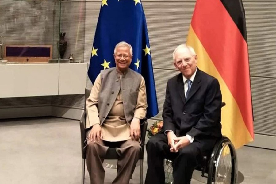 President of the Bundestag, Wolfgang Shauble discussing key economic issues with Nobel Laureate Professor Muhammed Yunus at the former's office in Berlin on Wednesday local time. Nasir Ali Mamun/Yunus Centre.