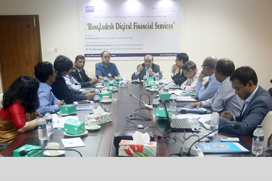 Chairman of Policy Research Institute of Bangladesh (PRI) Dr Zaidi Sattar (centre, right) speaking at a roundtable on 'Bangladesh Digital Financial Services' at the PRI conference room in the city on Tuesday. On his right is PRI Vice Chairman Dr Sadiq Ahmed — FE photo