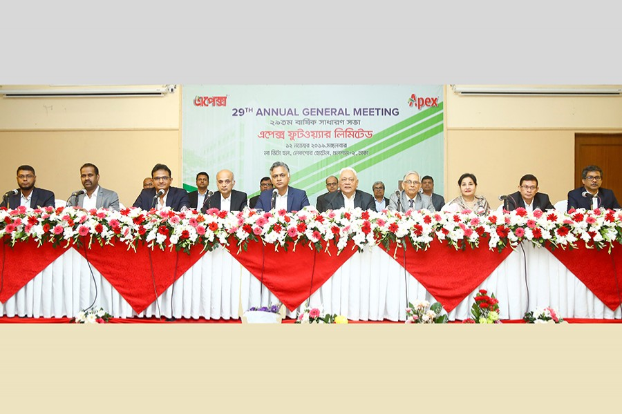 Mr Syed Manzur Elahi (fifth from right), chairperson of Apex Footwear Limited, presiding over the annual general meeting, which was also attended by Mr Syed Nasim Manzur (fifth from left), managing director, and other senior officials of the company