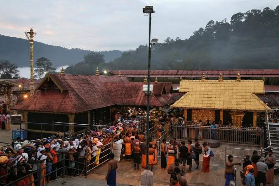 Hindu devotees wait in queues inside the premises of the Sabarimala temple in Pathanamthitta district in the southern state of Kerala, India, October 18, 2018. REUTERS/Sivaram V