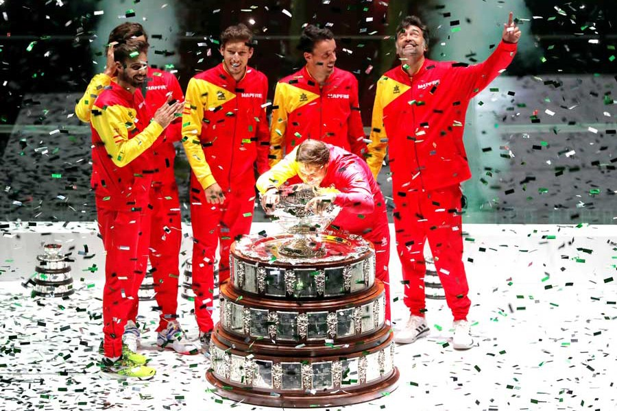 Spain's Rafael Nadal celebrating with the trophy and teammates after winning the Davis Cup final against Canada at the Davis Cup Madrid Finals 2019 in Madrid on Sunday— Reuters