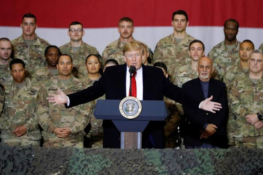 US President Donald Trump delivers remarks to U.S. troops in an unannounced visit to Bagram Air Base, Afghanistan, November 28, 2019. REUTERS/Tom Brenner RARE WAR ZONE VISIT