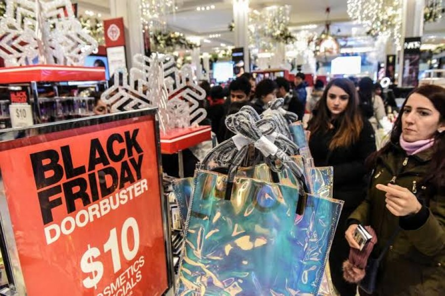 FILE PHOTO: People shop during a Black Friday sales event at Macy's flagship store on 34th St. in New York City, U.S., November 22, 2018. REUTERS/Stephanie Keith/File Photo