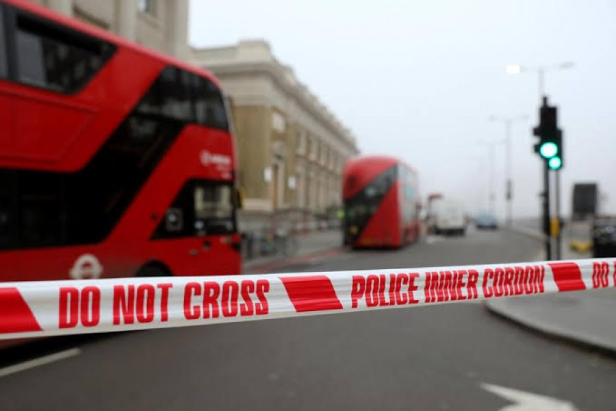 Police cordon is seen at the scene of a stabbing on London Bridge, in which two people were killed, in London, Britain, November 30, 2019. REUTERS/Simon Dawson