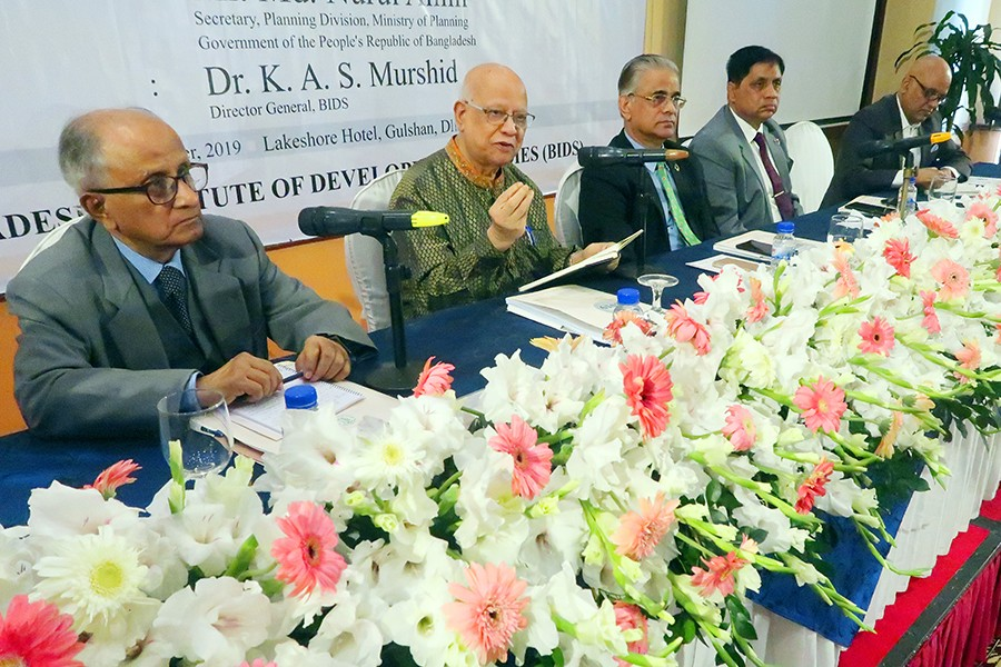 Former Finance Minister A M A Muhith speaking at the inaugural session of the BIDS-organised two-day research almanac in the city on Sunday. Former finance minister M. Syeduzzaman (extreme left), Bangladesh Planning Commission Member Dr. Shamsul Alam (centre), Planning Division Secretary Md. Nurul Alam (2nd, right) and BIDS Director General Dr K A S Murshid are also seen — FE Photo