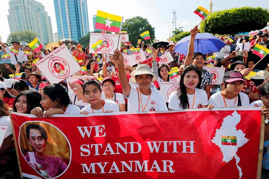 People gathering in a rally in support of Myanmar State Counsellor Aung San Suu Kyi before she heads off to the International Court of Justice (ICJ), in Yangon, Myanmar  on Sunday. -Reuters Photo