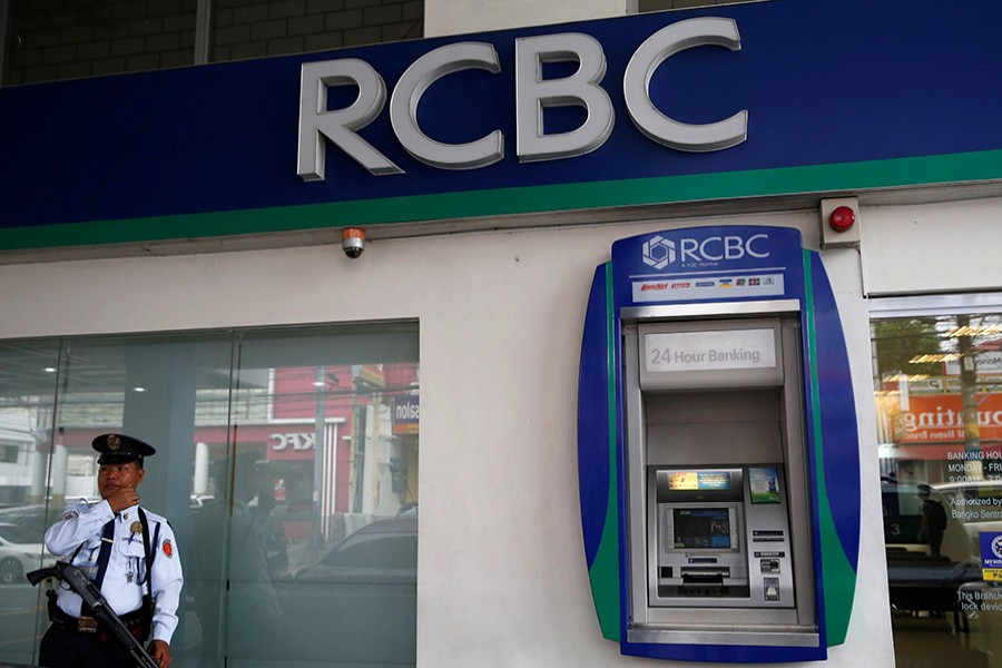 A security guard stands guard outside a branch of Rizal Commercial Banking Corporation (RCBC) in Paranaque city, Metro Manila in Philippines on August 2, 2016 — Reuters/Files