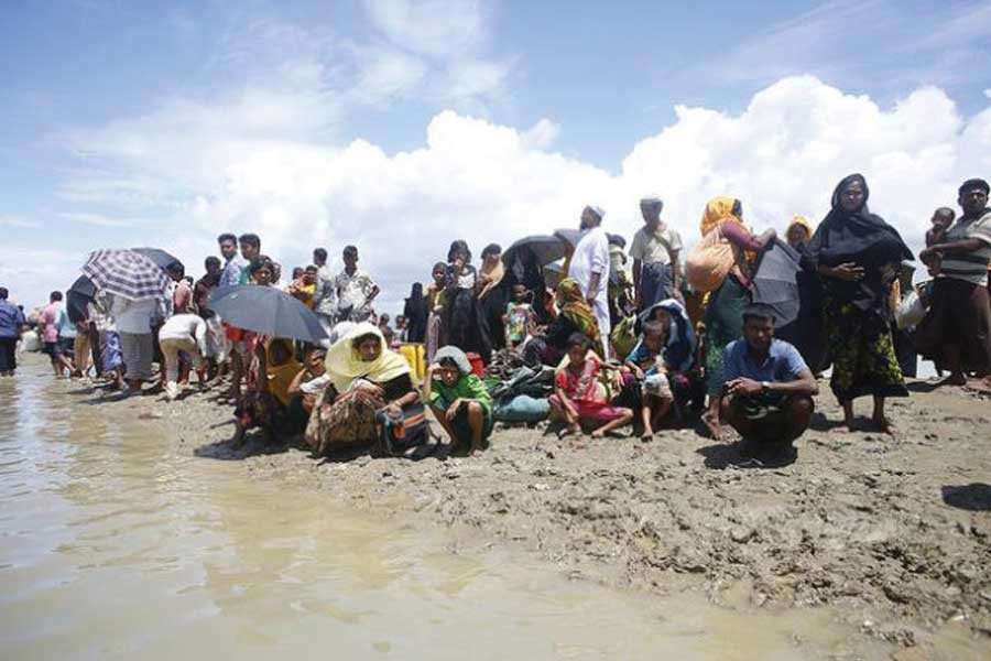A group of Rohingyas after they fled Myanmar in 2017 arrive at Shahparir Dip in Teknaf, Bangladesh.  —Photo credit: IPS