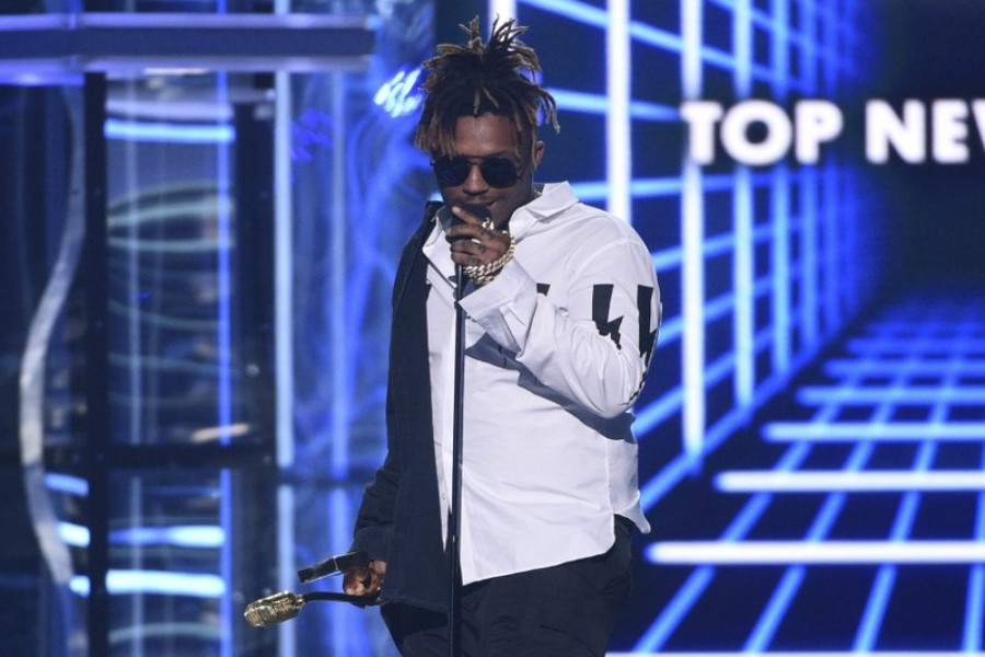 In this May 1, 2019 file photo, Juice WRLD accepts the award for top new artist at the Billboard Music Awards at the MGM Grand Garden Arena in Las Vegas - Photo by Chris Pizzello/Invision/AP, File