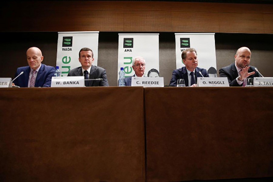 WADA Director, Intelligence and Investigations, Gunter Younger, WADA President-Elect, Witold Banka, WADA President, Sir Craig Reedie, WADA Director General, Olivier Niggli and Chair of the CRC, Jonathan Taylor QC attend a news conference after World Anti-Doping Agency's extraordinary Executive Committee (ExCo) meeting that has banned Russian athletes from all major sporting events in the next four years, in Lausanne, Switzerland on December 9, 2019 — Reuters photo