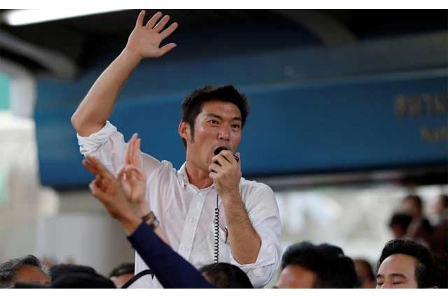 Thanathorn Juangroongruangkit of Thailand's progressive Future Forward Party talks to his supporters during an unauthorised flash mob rally in Bangok, Thailand Dec 14, 2019. REUTERS
