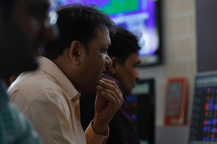 A broker reacts while trading at his computer terminal at a stock brokerage firm in Mumbai, December 28, 2017. Reuters/File Photo