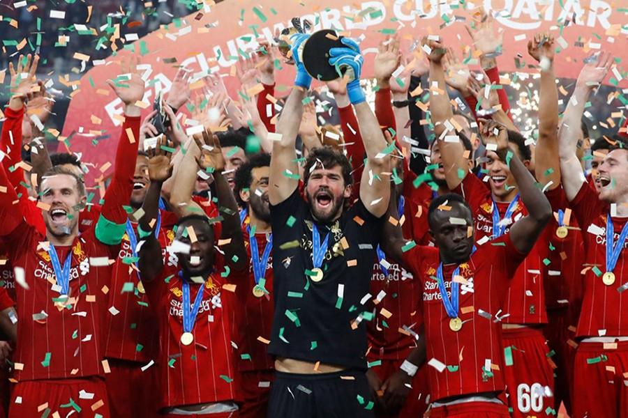 Liverpool's Alisson lifts the trophy as they celebrate after winning the Club World Cup — Reuters photo
