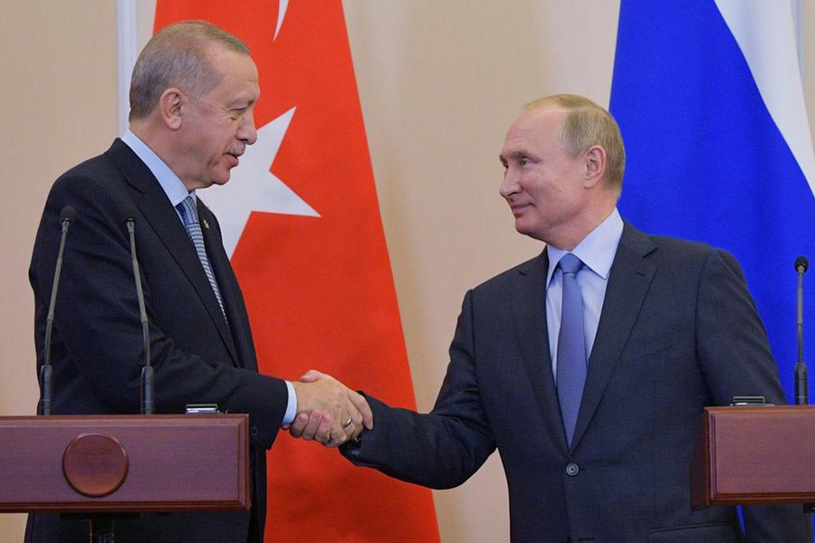 Turkish President Tayyip Erdogan shaking hands with Russian President Vladimir Putin during a news conference following their talks in Russia in October. -Reuters file photo