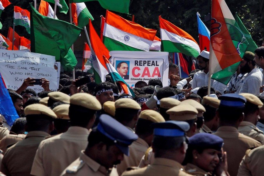 Police officers stand as demonstrators gather to attend a protest, organised by various political parties, against a new citizenship law, in Chennai, India, December 23, 2019. Reuters