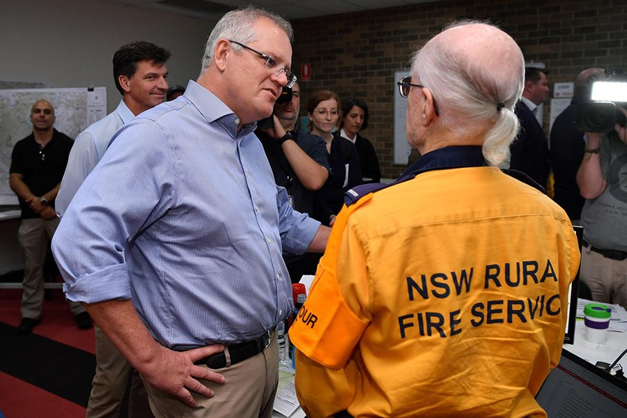 Australia's Prime Minister Scott Morrison greets a volunteer during a visit to the Wollondilly Emergency Control Centre in Sydney, Australia on December 22, 2019 — AAP Image via Reuters