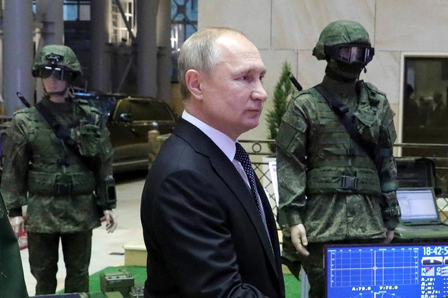Russian President Vladimir Putin going to the National Defence Control Centre in Moscow of Russia to attend an annual meeting with top military officials on Tuesday. -AP Photo
