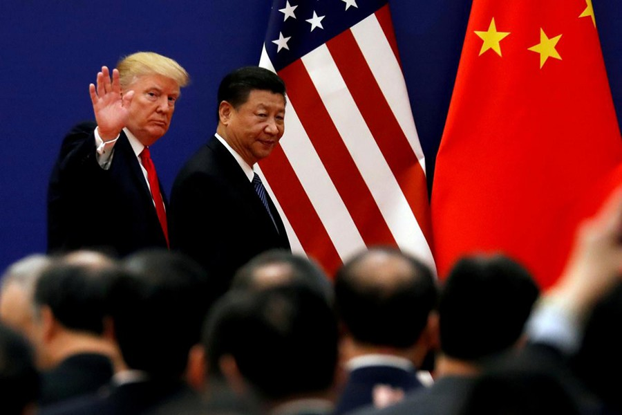 US President Donald Trump and China's President Xi Jinping meet business leaders at the Great Hall of the People in Beijing, China on November 9, 2017 — Reuters/Files