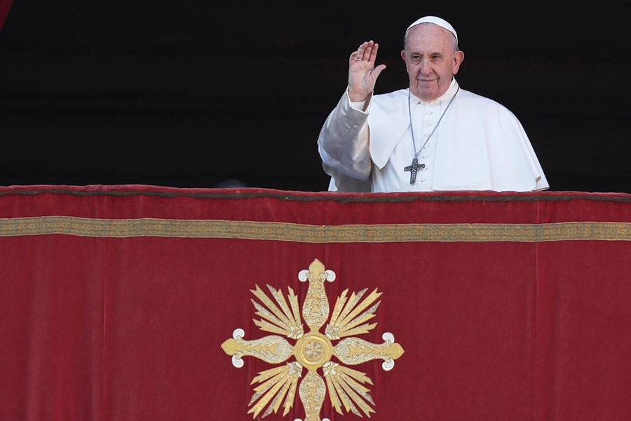 Pope Francis gesturing as he arrives to deliver the 'Urbi et Orbi' Christmas Day message from the main balcony of St. Peter's Basilica at the Vatican on Wednesday. -Reuters Photo