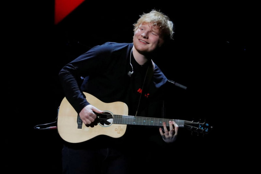 FILE PHOTO: Ed Sheeran performs during the 2017 Jingle Ball at Madison Square Garden in New York - Reuters