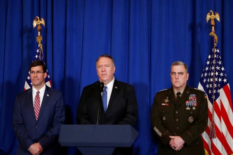 US Secretary of State Mike Pompeo speaks about air strikes by the US military in Iraq and Syria, at the Mar-a-Lago resort in Palm Beach, Florida, US, December 29, 2019. With him are US Army General Mark Milley and US Defense Secretary Mark Esper. Reuters