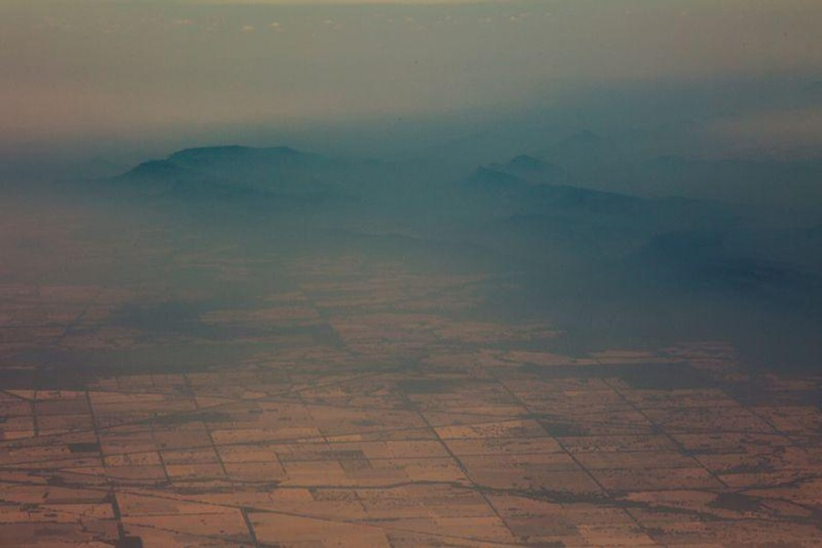 Smoke and haze over mountains are seen from a No 11 Squadron P-8A Poseidon conducting damage assessment and surveillance in the bushfire-affected area near Cooma, New South Wales, Australia on January 7, 2020 — Australian Department of Defence/Handout via REUTERS