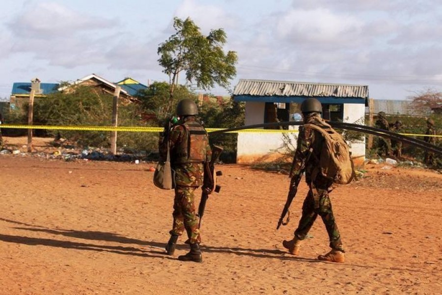 Kenya Defence Forces soldiers walk near the scene of an overnight attack on a residential complex in Mandera town at the Kenya-Somalia border July 7, 2015. REUTERS/Stringer