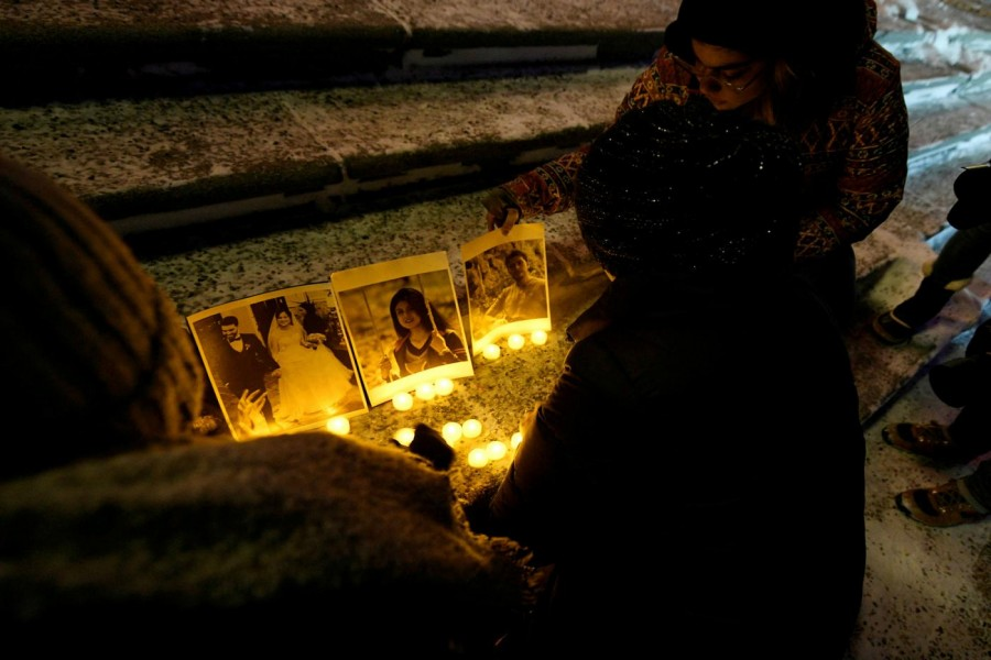People attend a candlelight vigil held at the Edmonton Legislature building, in memory of the victims of a Ukrainian passenger plane that crashed in Iran, in Edmonton, Alberta, Canada (Reuters)