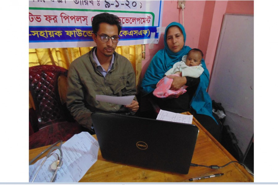 A mother is consulting a doctor through videoconferencing at an e-health camp in Shilkhali Union Parishad of Cox's Bazar recently