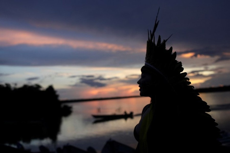 Indigenous leader of the Celia Xakriaba tribe walks next to the Xingu River during a four-day pow wow in Piaracu village, in Xingu Indigenous Park, near Sao Jose do Xingu, Mato Grosso state, Brazil on January 15, 2020 — Reuters photo