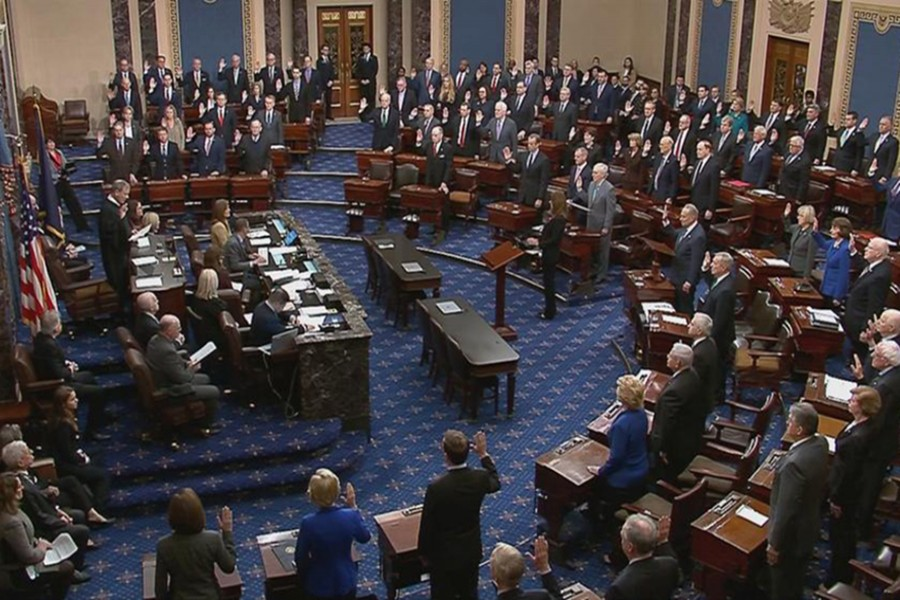 Chief Justice of the United States John Roberts swears in senators during the procedural start of the Senate impeachment trial of US President Donald Trump in this frame grab from video shot in the Senate Chamber at the US Capitol in Washington, US on January 16, 2020 — US Senate TV/Handout via Reuters