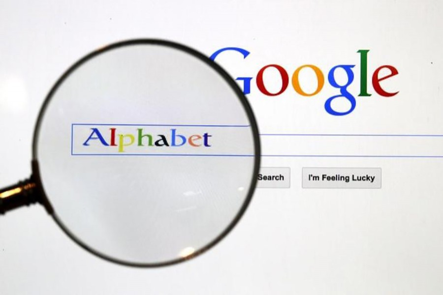 A Google search page is seen through a magnifying glass in this photo illustration taken in Berlin on August 11, 2015 — Reuters/Files
