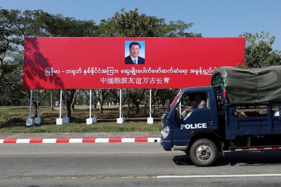The Reuters photo shows a banner welcoming Chinese President Xi Jinping ahead of his visit to Myanmar in Naypyitaw, Myanmar