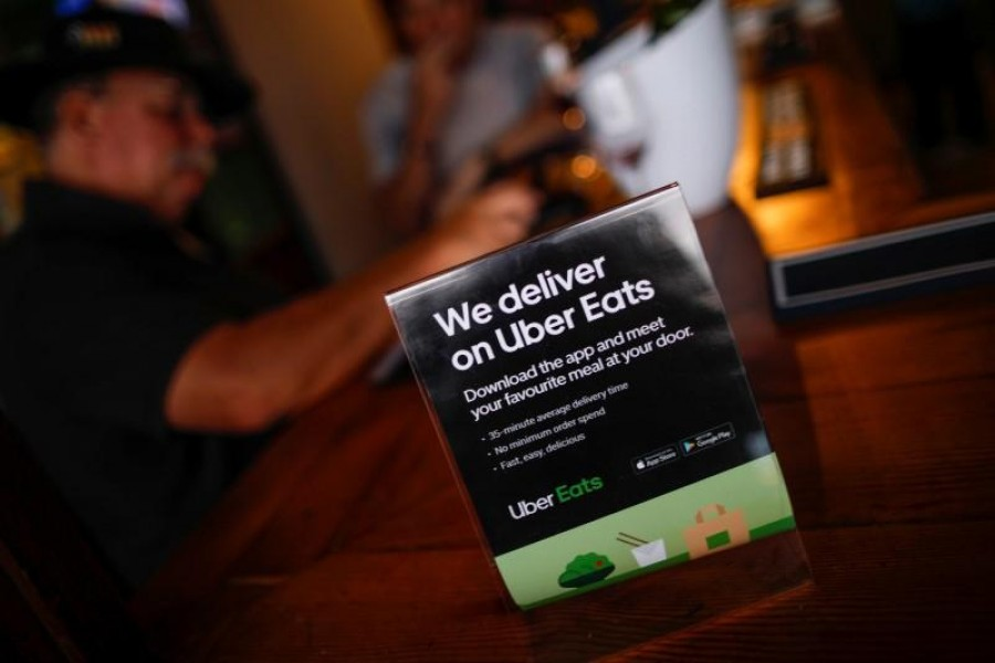 A flyer advertising Uber Eats delivery service is pictured at a restaurant in Cape Town, South Africa, January 2, 2020. REUTERS/Mike Hutchings/Files