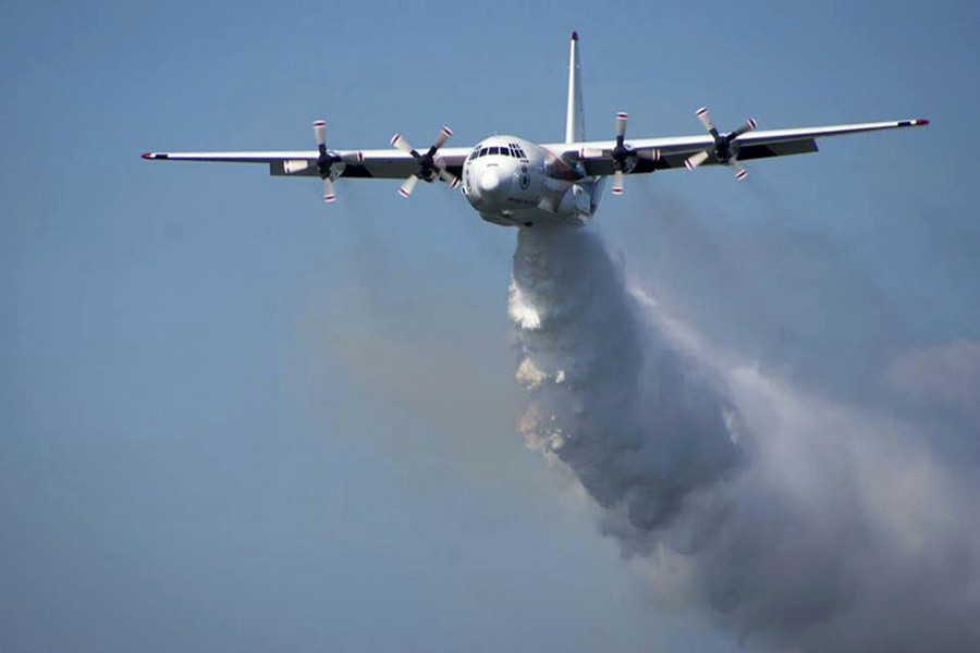 In this undated photo released from the Rural Fire Service, a C-130 Hercules plane called 'Thor' drops water during a flight in Australia. Picture used only for representation —  RFS via AP