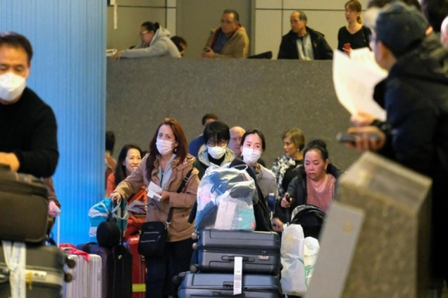 Passengers arrive at LAX from Shanghai, China, after a positive case of the coronavirus was announced in the Orange County suburb of Los Angeles, California, US, January 26, 2020. Reuters