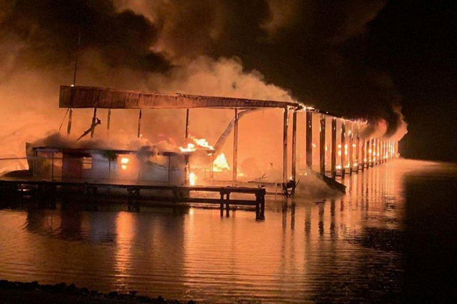 A row of boats are engulfed in flames after catching fire at the marina in Scottsboro, Alabama, US on January 27, 2020 — Southern Torch via REUTERS