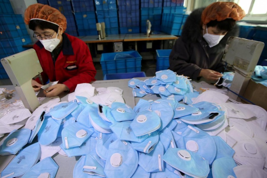 Workers make protective masks at a factory in Handan, Hebei province, China on January 22, 2020 — China Daily via REUTERS