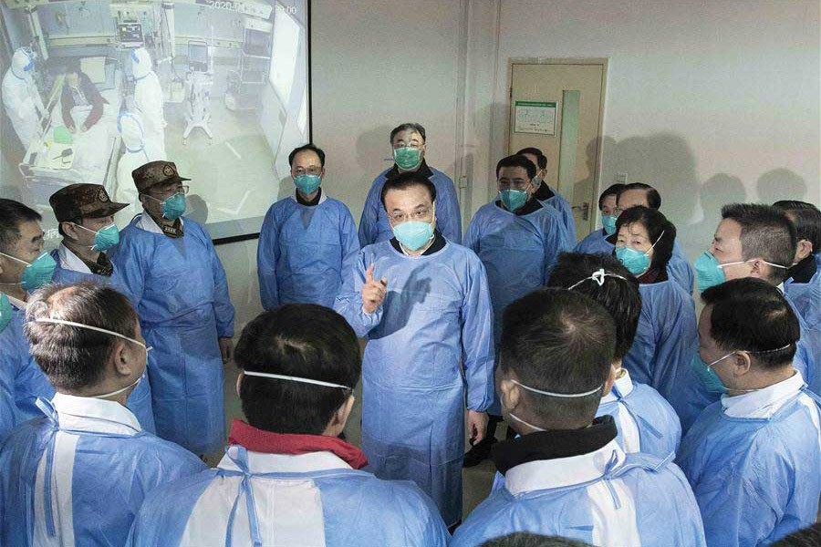 Entrusted by President  Xi Jinping, general secretary of the Communist Party of China (CPC) Central Committee, Premier Li Keqiang (clad in a blue protective suit and mask) visited Wuhan to inspect and direct the efforts for the prevention and control of the novel coronavirus outbreak. —Photo: Xinhua